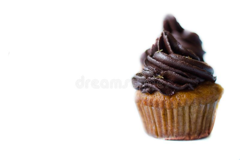 Birthday cupcake with the chocolate frosting on the top. Birthday cupcake with chocolate frosting on the top on the table stock photo
