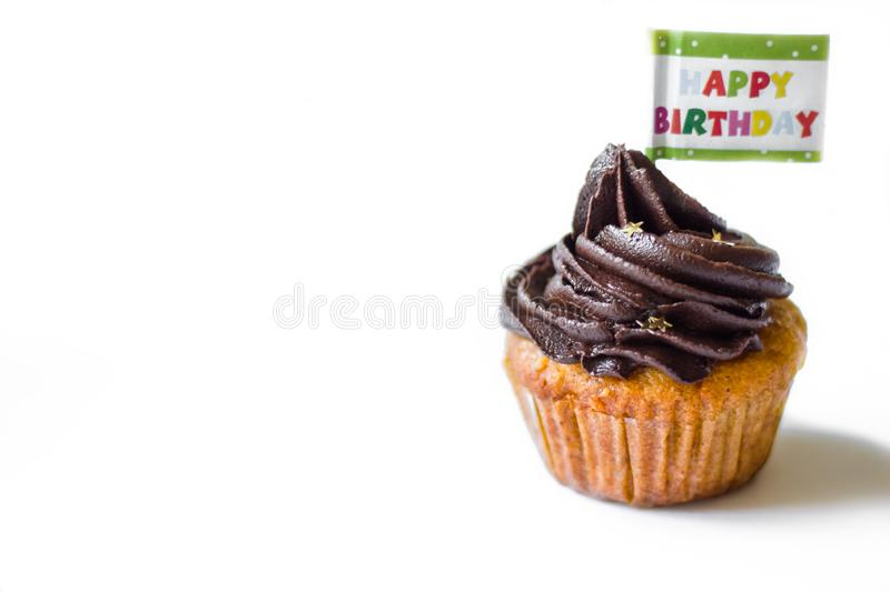 Birthday cupcake with the chocolate frosting on the top isolated. Birthday cupcake with chocolate frosting on the top on the table stock photos