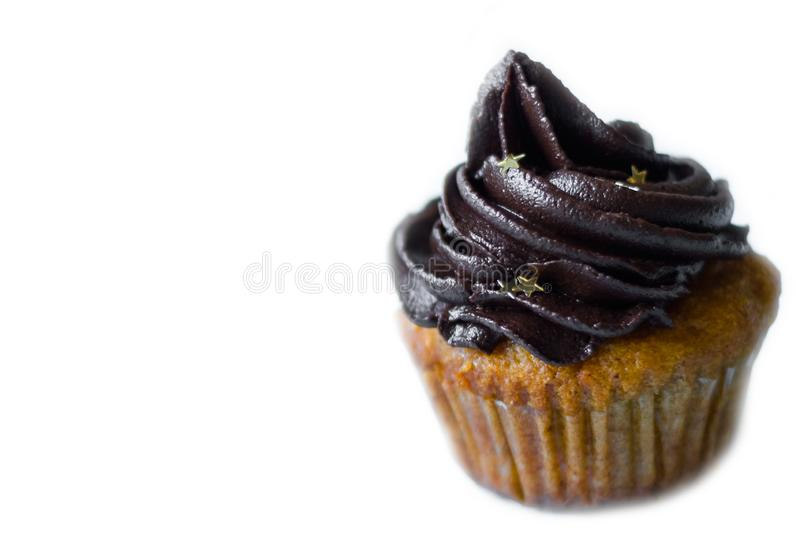 Birthday cupcake with the chocolate frosting on the top. Birthday cupcake with chocolate frosting on the top, on white royalty free stock photos