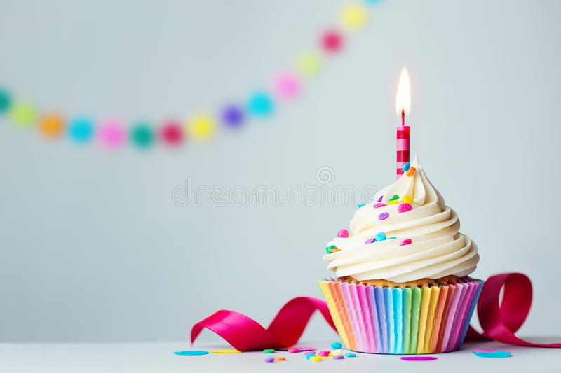 Birthday cupcake. Colorful cupcake with red candle stock photo