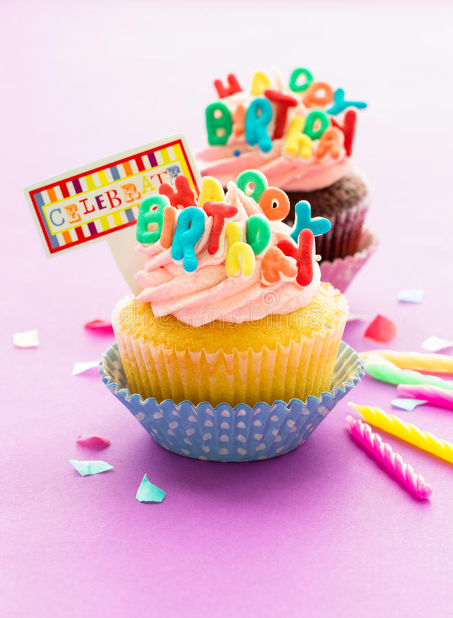 Birthday Cupcake. S on pink background royalty free stock photography