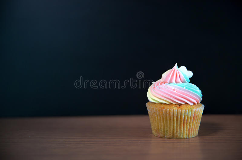 Birthday cupcake in front of a chalkboard.mini cake royalty free stock images