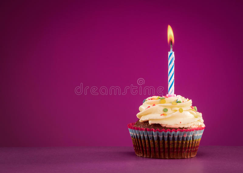 Birthday cupcake. On the pink background royalty free stock images
