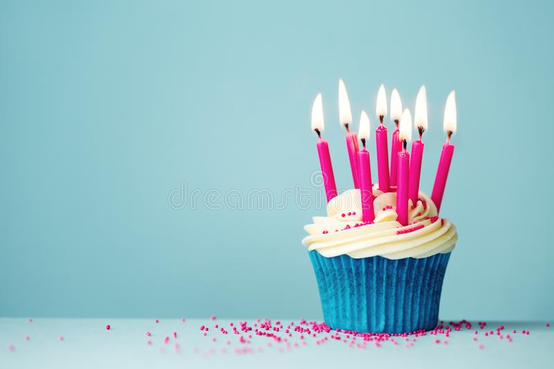 Birthday cupcake with pink candles royalty free stock image