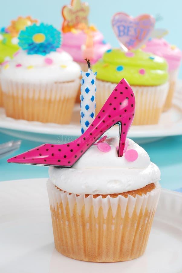 Birthday cupcake pink polka dot high heel shoe. Closeup of a Birthday cupcake with pink polka dot high heel shoe stock photo