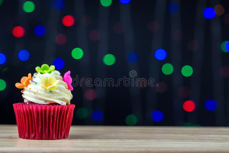 Birthday cupcake with a single blue candle.Cupcake with yellow cream and heart for love valentines.green crown cupcakes with cream. Cheese frosting and a Color royalty free stock photography
