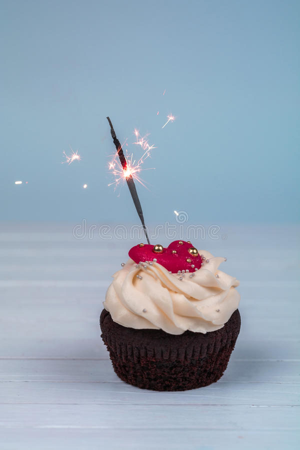 Birthday cupcake with sparkler. Cupcakes for Valentine`s Day wit royalty free stock images