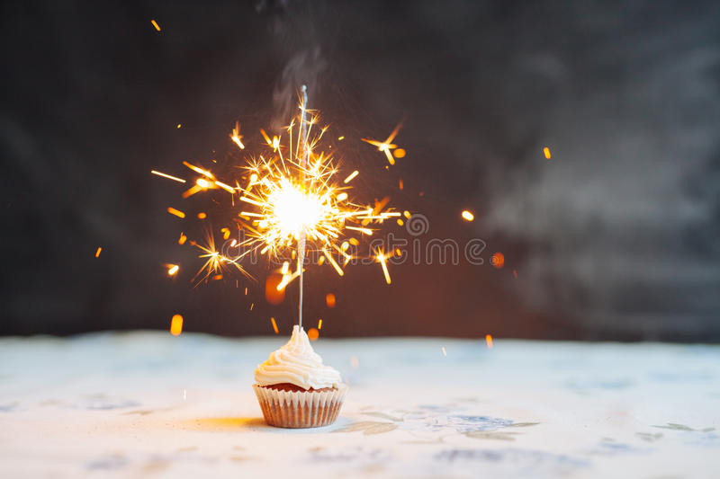 Birthday Cupcake with a sparkler royalty free stock images