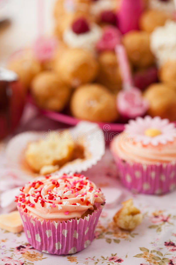 Birthday cupcake with sprinkles. Birthday cupcake decorated with sprinkles. Leftovers are beside the cupcake royalty free stock image