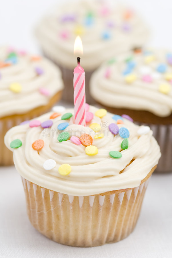 Birthday Cupcakes. This image shows a birthday cupcake with a burning candle royalty free stock images