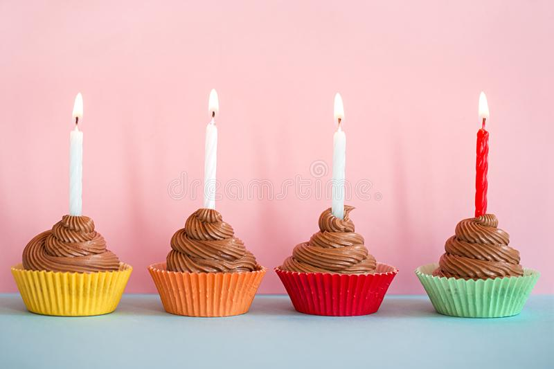 Birthday cupcakes. With the burning candles stock photography