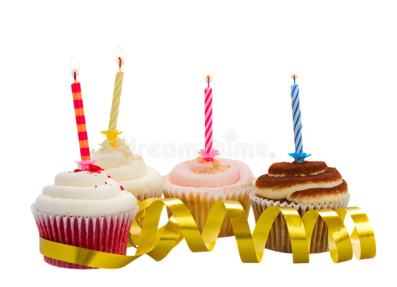 Birthday cupcakes. With burning candles isolated on white background stock image