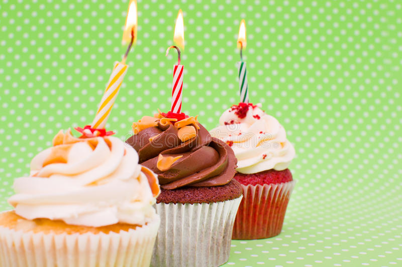 Birthday cupcakes. Cupcakes on green vintage background royalty free stock photography