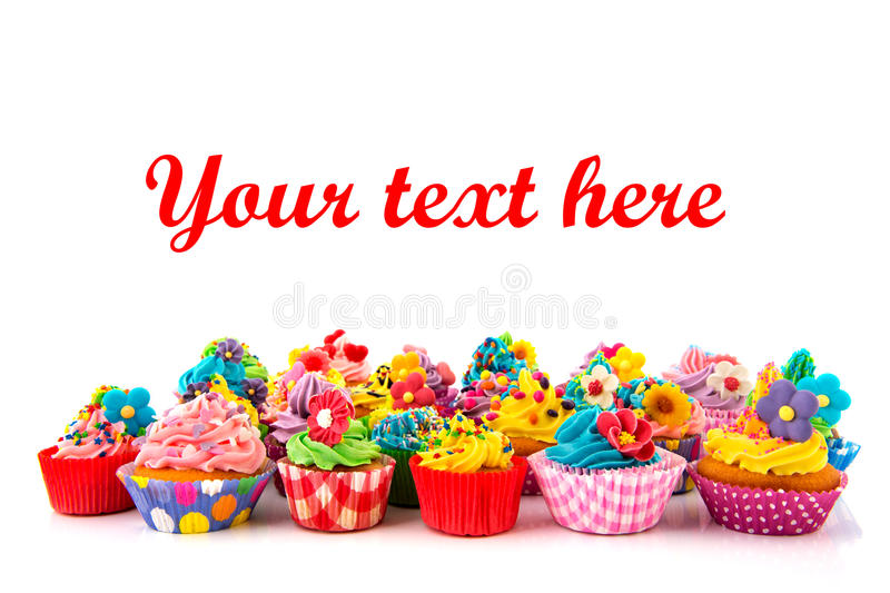 Birthday cupcakes. Many sweet birthday cupcakes with flowers and butter cream royalty free stock photos