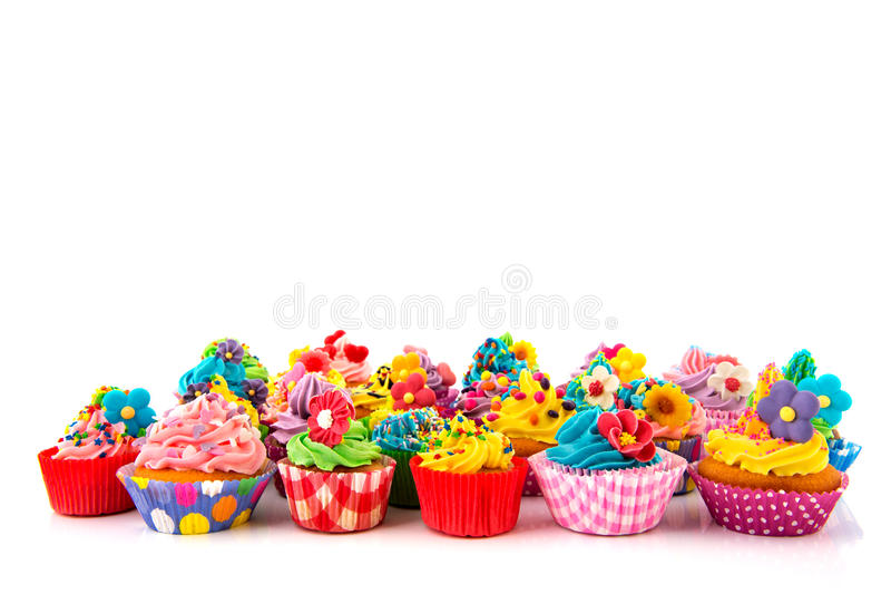 Birthday cupcakes. Many sweet birthday cupcakes with flowers and butter cream royalty free stock images