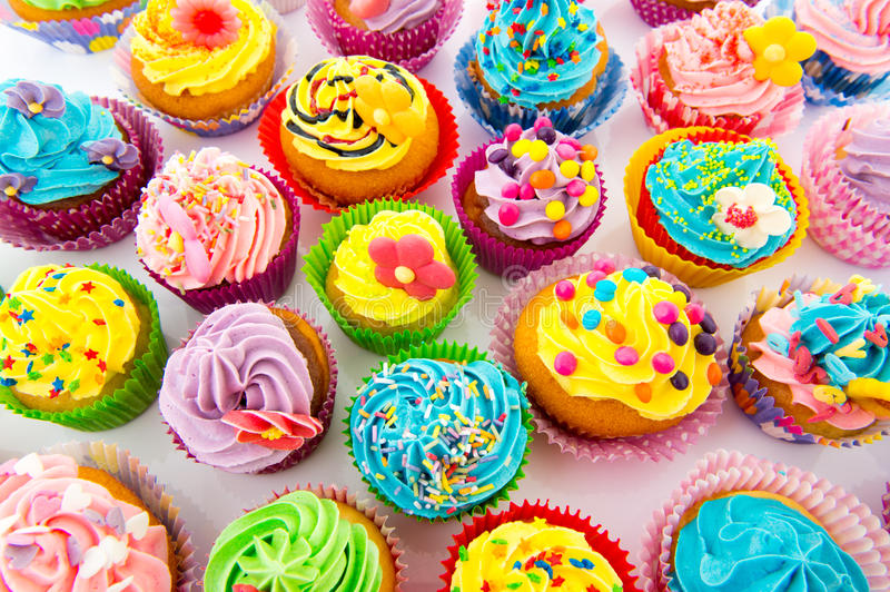 Birthday cupcakes. Many sweet birthday cupcakes with flowers and butter cream royalty free stock photography