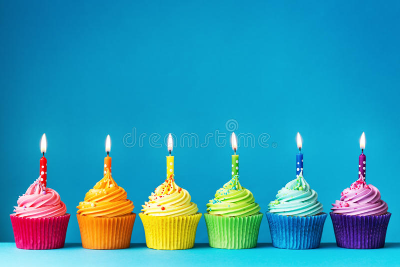 Birthday cupcakes. In rainbow colors stock photography