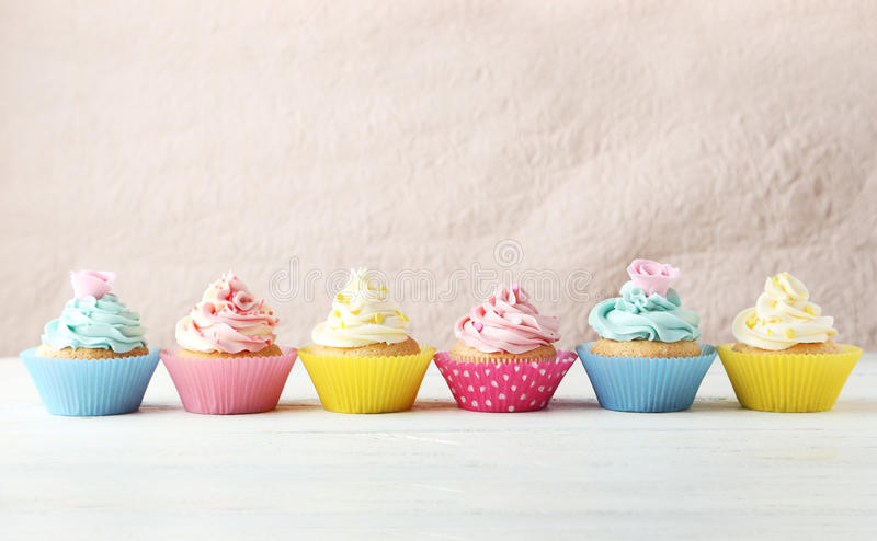 Birthday cupcakes on a white wooden background. Birthday cupcakes on white wooden background stock photo