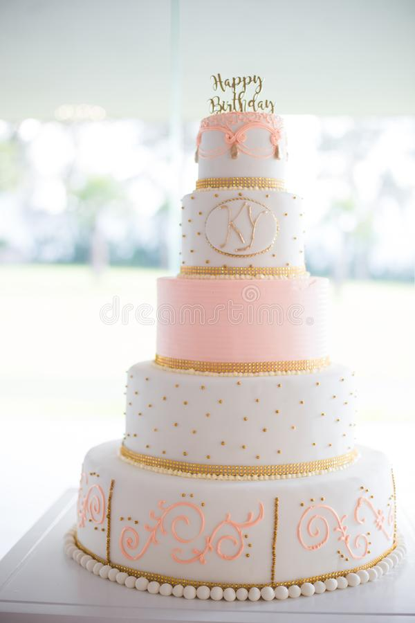 Birthday five-tiered white and pink cake. Decorated with handmade pattern stock photo