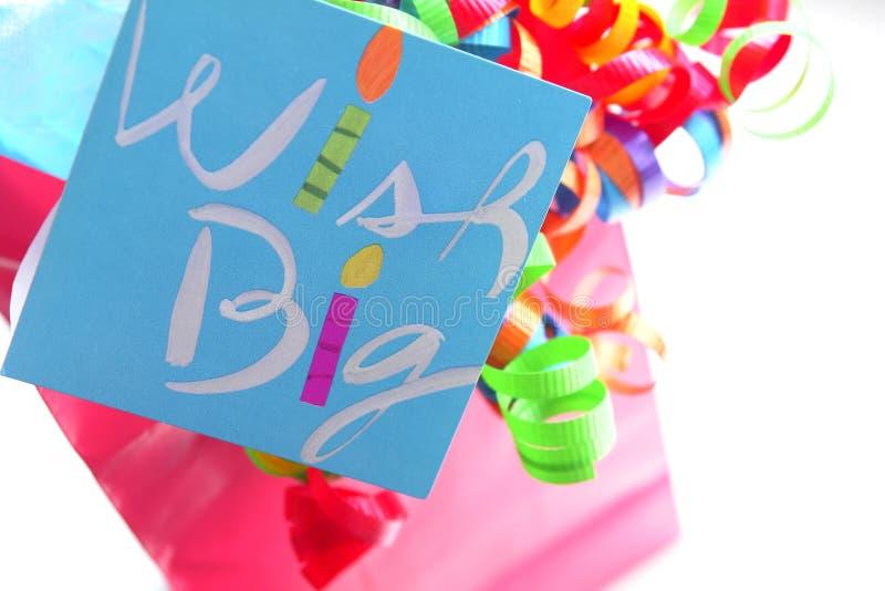 Birthday Gift Bag. Pink gift bag with colorful ribbon and birthday card stock image