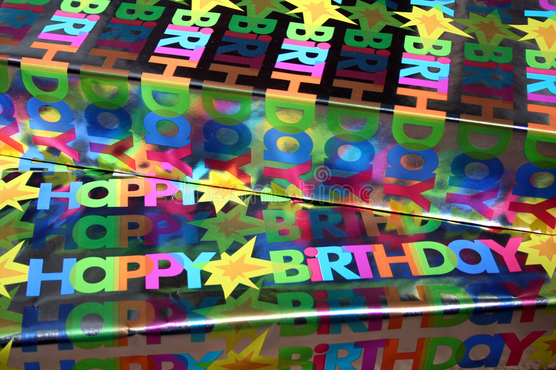 Birthday Gifts. These gifts are wrapped and ready to open with the words Happy Birthday on the paper stock photography