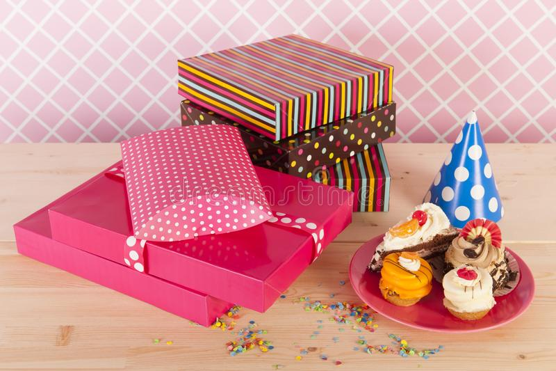 Birthday gifts and cakes. Colorful birthday gifts and fancy cakes for the celebration party stock photography