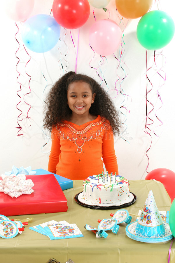 Birthday Girl. Adorable 8 year old African American girl at birthday party stock photos