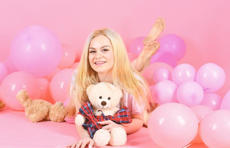 Birthday girl concept. Woman cute celebrate birthday with balloons. Girl in pajama, domestic clothes lay near air. Balloons, pink background. Blonde on smiling royalty free stock photo