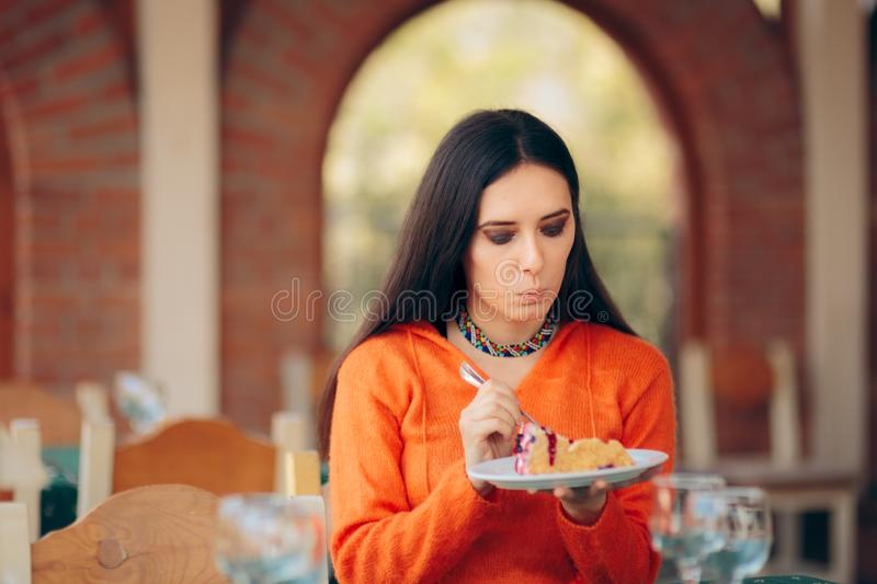 Funny Woman Eating Cake in a Restaurant royalty free stock photos