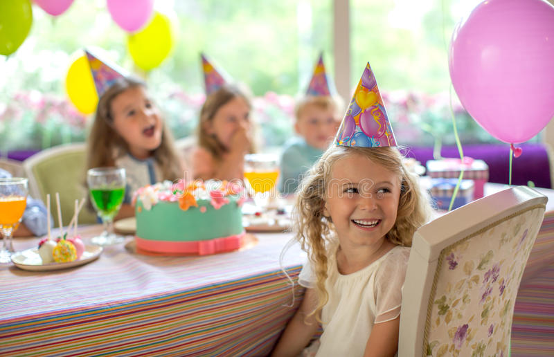 Birthday girl at home. Birthday girl at a birthday party royalty free stock image