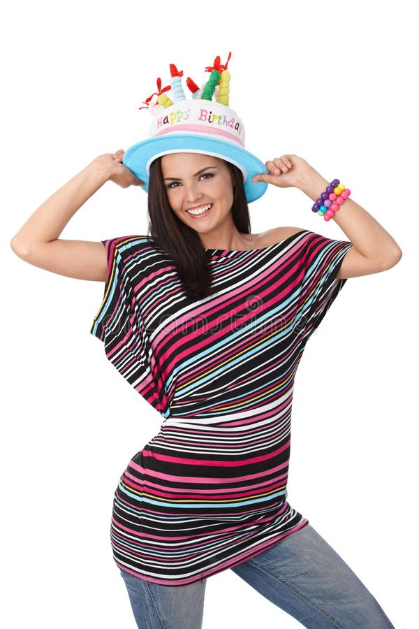 Birthday girl in party hat smiling. Birthday girl smiling in party hat, having fun, looking at camera stock images