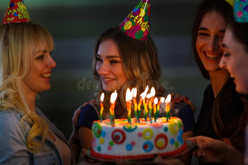 Birthday. Girls with a cake with candles. Best friends celebrate a birthday. stock images