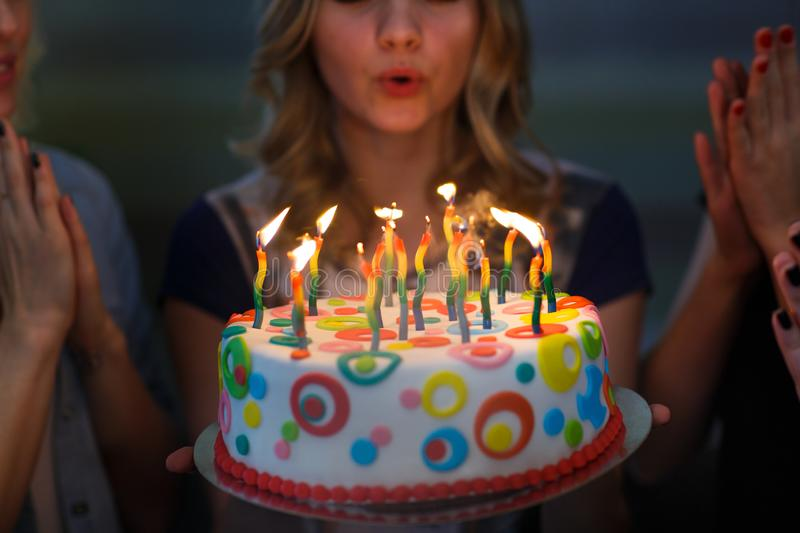 Birthday. Girls with a cake with candles. Best friends celebrate a birthday. royalty free stock photos