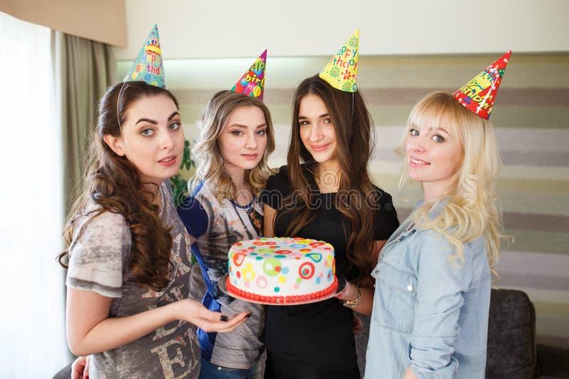 Birthday. Girls posing with cake on birthday royalty free stock photos