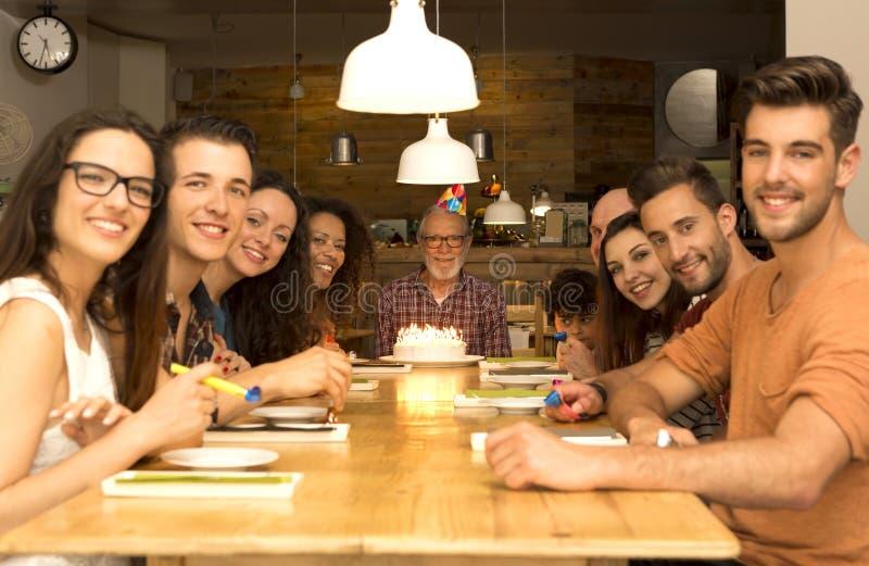 Birthday Grandfather. Big family celebrate the birthday of the grandfather stock photo
