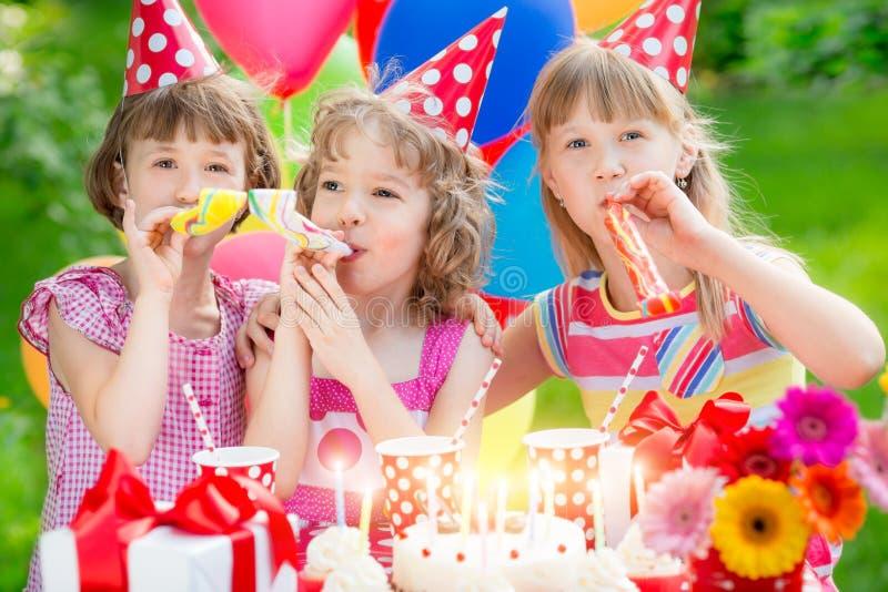 Birthday. Group of happy children celebrating birthday. Kids having fun in spring garden stock images