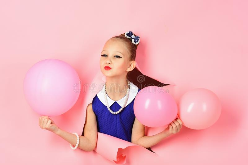 Birthday, happiness, childhood, look. Kid with balloons, birthday. Small girl child with party balloons, celebration stock photo