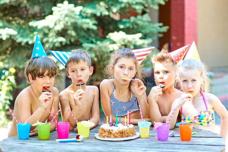 Birthday. Happy children hats with colorful candy. Birthday. Happy children in hats with colorful candy stock photography