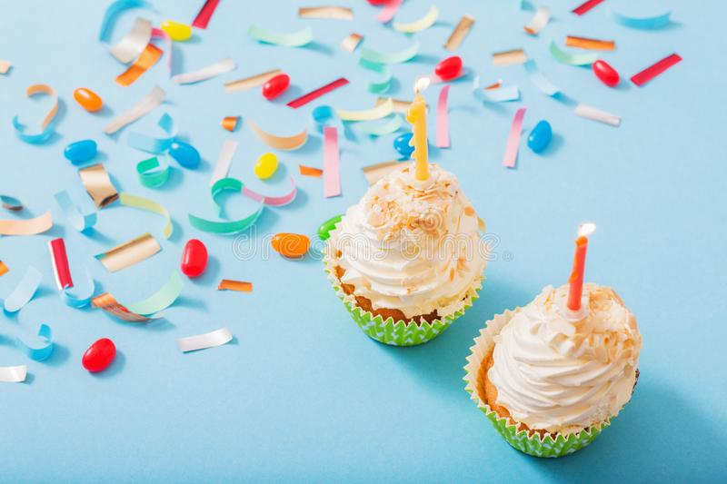Birthday hat with confetti and cupcake on  paper background royalty free stock photo