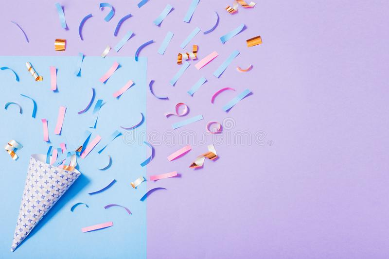 Birthday hat with confetti on paper background. The birthday hat with confetti on paper background royalty free stock photo