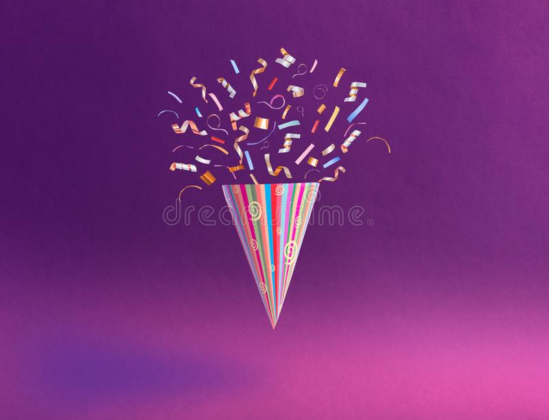 Birthday hat with confetti on paper background stock image