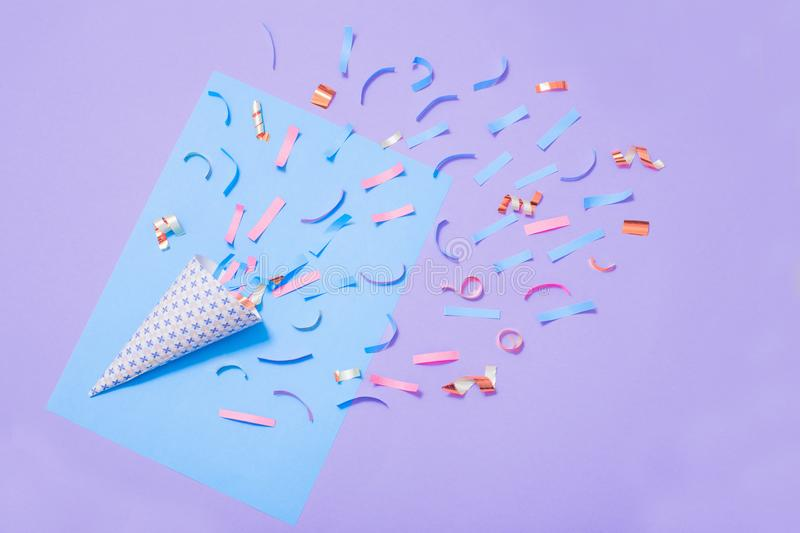Birthday hat with confetti on paper background. The birthday hat with confetti on paper background royalty free stock photography