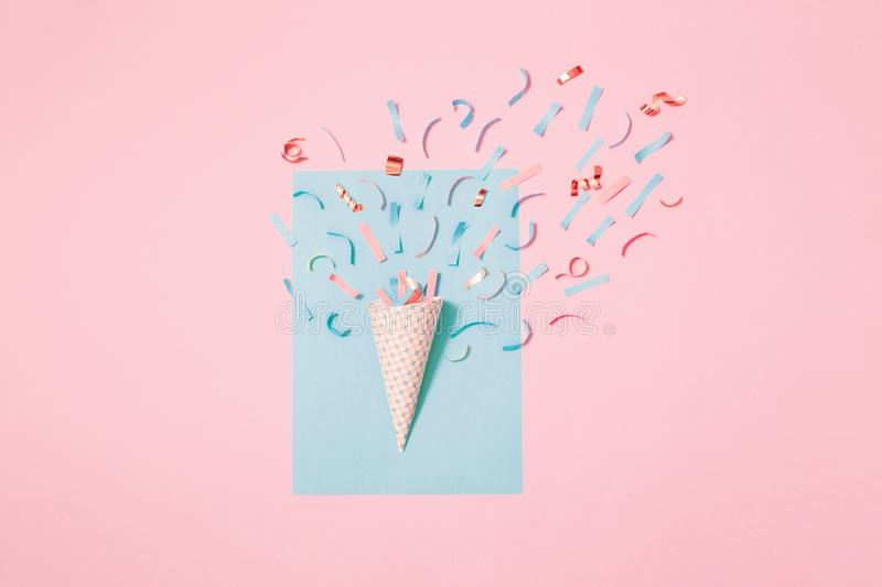 Birthday hat with confetti on paper background. The birthday hat with confetti on paper background royalty free stock image