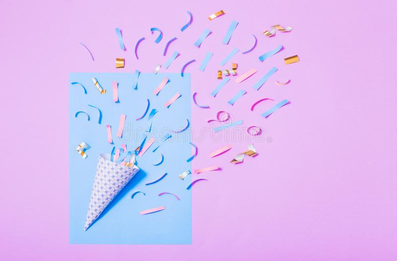 Birthday hat with confetti on paper background. The birthday hat with confetti on paper background royalty free stock photos