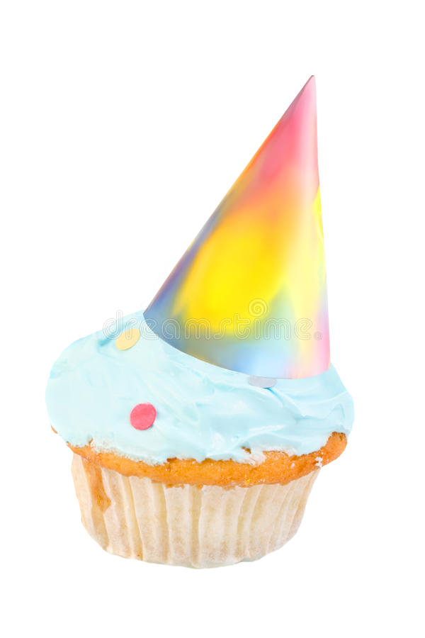 Birthday hat cupcake. Frosted cupcake with colorful birthday party hat isolated on a white background stock photo