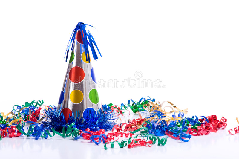Birthday Hat and Streamers. A brightly colored birthday hat and streamers on a white background with copy space royalty free stock photos