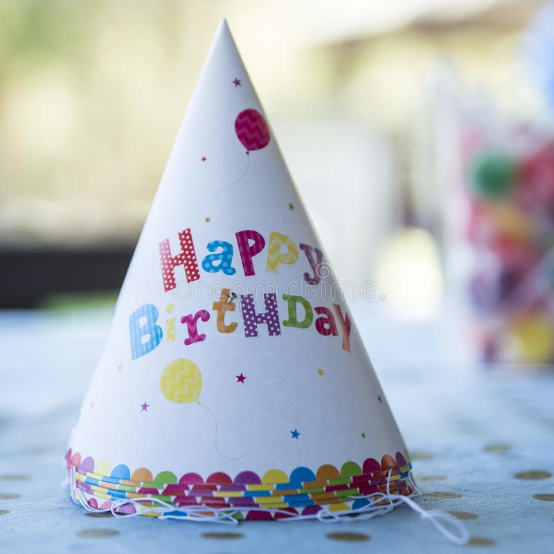 Birthday hat on a table.  royalty free stock photos