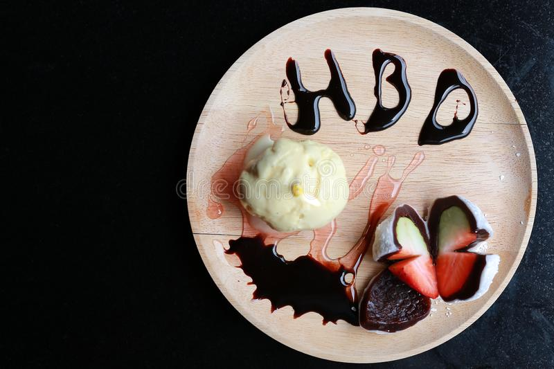 Birthday ice-cream cake with HBD sign on wooden plate with copy space, Top view stock photography