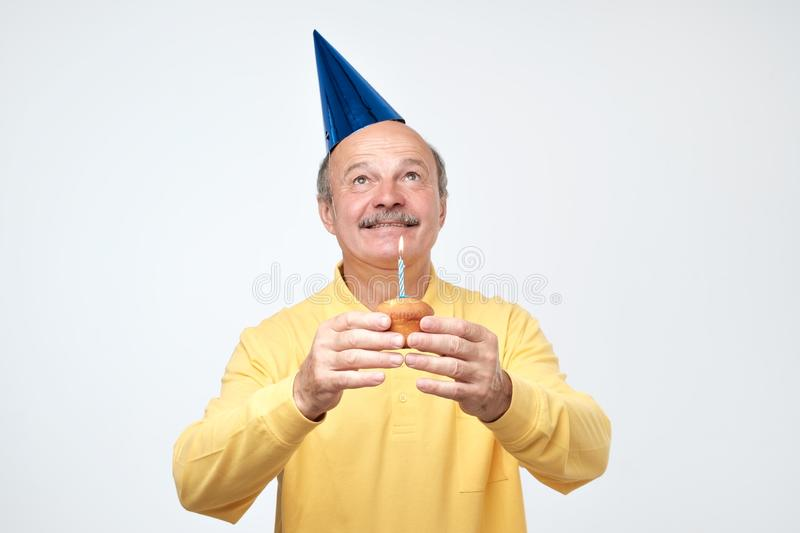 Birthday mature man with party hat is happy on his party royalty free stock photo