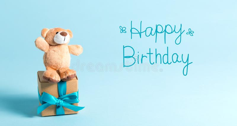 Birthday message with teddy bear. And gift box stock photos